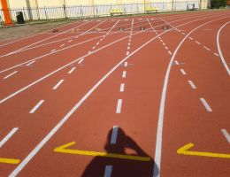 Retopping of running track at municipal stadium of Kalamata, Greece